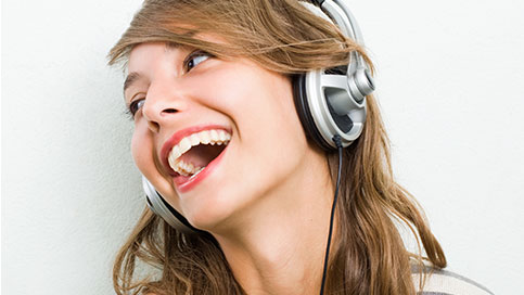 woman wearing Headphone:X headphones